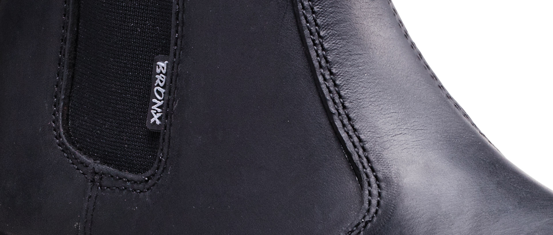 chelsea_black_specific_shoe_screen_width_detail_shot_1920px_818px